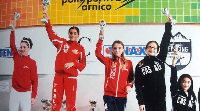 Arianna Paganini (Pettorelli) sul podio, terza da sinistra