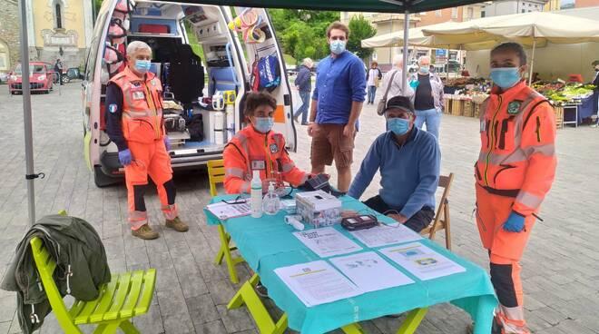 I volontari della Pubblica Valtrebbia in un mercato